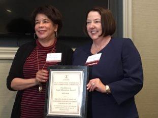 Wendy accepts award